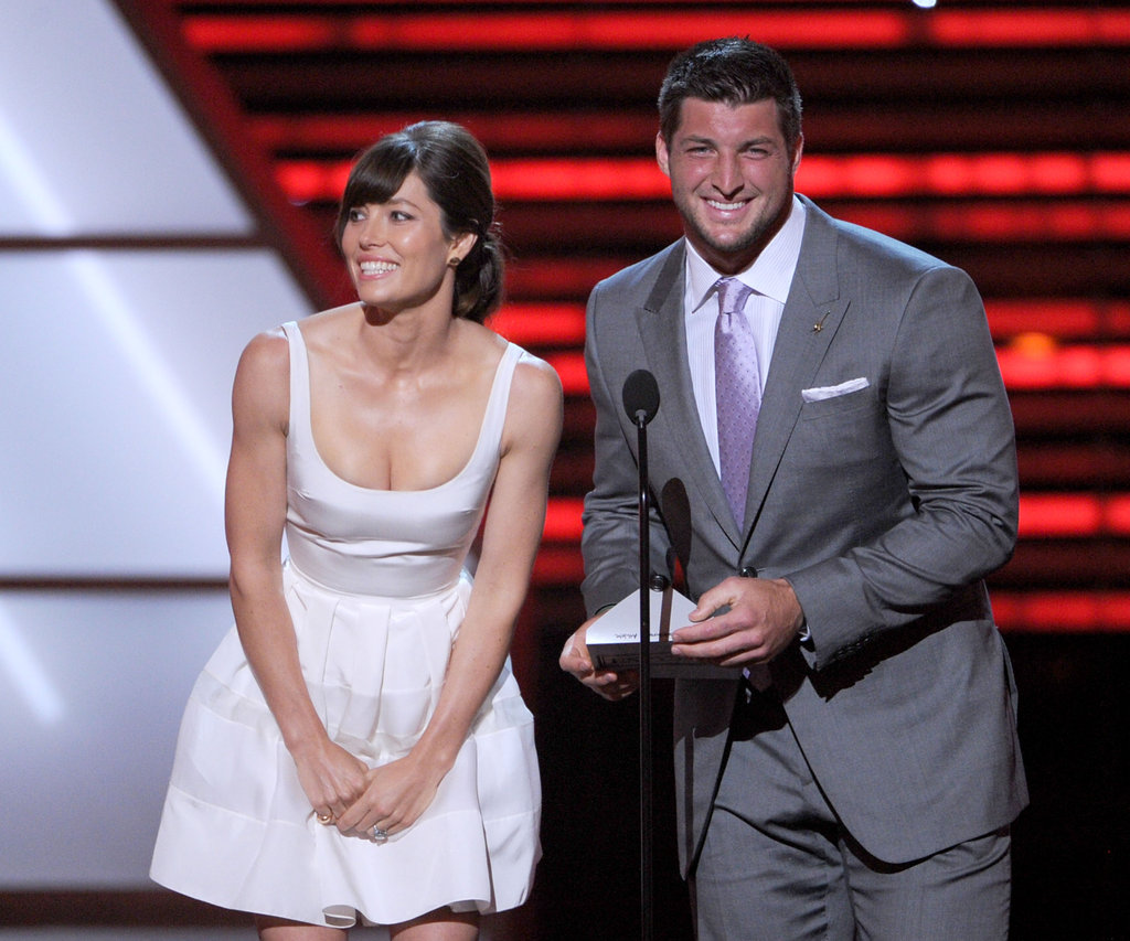 Presenters Jessica Biel and Tim Tebow smiled onstage.