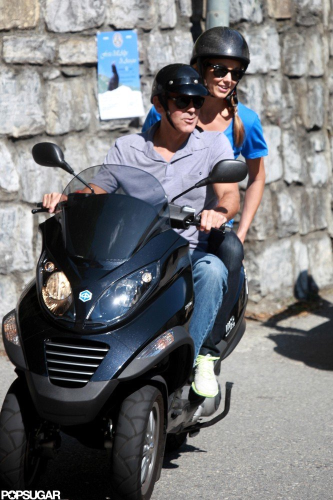 Stacy Keibler was all smiles during her scooter ride with George Clooney in Switzerland.