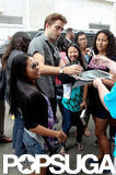 Robert Pattinson signed autographs at Comic-Con.
