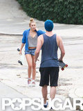 Miley Cyrus talked with Liam Hemsworth while skateboarding in LA.