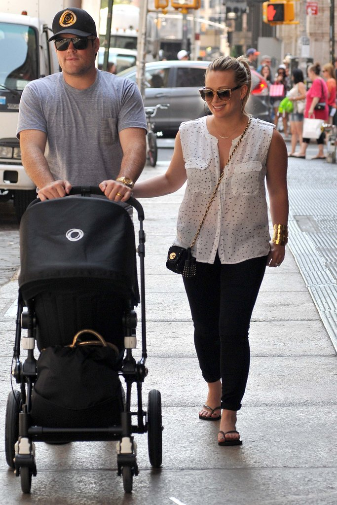 Hilary Duff and Mike Comrie went to NYC with baby Luca.