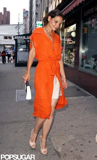 Katie Holmes in bright orange.