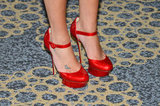Lea's red Nicholas Kirkwood pumps are a serious shoe statement.