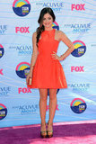 Lucy Hale sported a bright orange cutout dress and colorful heels.