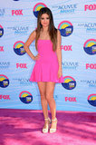 Selena Gomez opted for a hot pink Dsquared2 dress and nude Herve Leger heels.