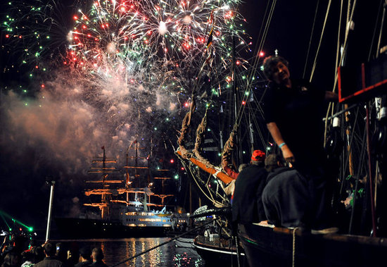 Fireworks lit up the sky above Brest Bay as part of the shipping festival, Tonnerres de Brest, during the annual Bastille Day celebrations in Western France.