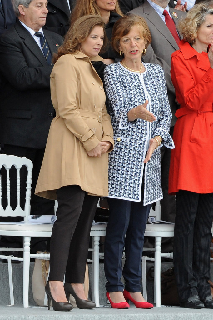 Valérie Trierweiler chatted with Brigitte Ayrault, wife of France's Prime Minister Jean-Marc Ayrault, during the Bastille Day Military Ceremony in Paris.