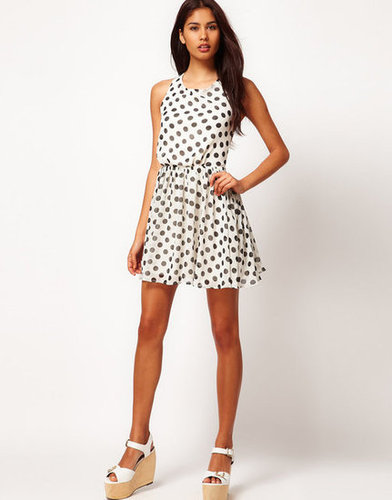 This open-backed little number would be the perfect thing for catching rays at a backyard cocktail party.  Rare Chiffon Spot Cross Back Skater Dress ($60, originally $86)