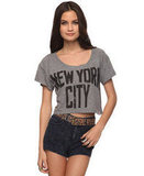 """Every time we spot this """"New York City"""" t-shirt, we're reminded of the late John Lennon wearing his own version complete with retro round sunglasses.  Forever 21 New York City Top ($13)"""