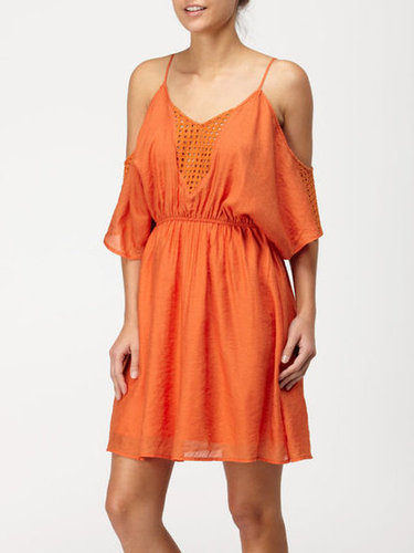Breezy cutouts coupled with an off-the-shoulder neckline and a tangerine hue means this little dress will help combat the climbing temperatures and keep you chic at your next outdoor party.  QSW Indian Summer Dress ($53, originally $88)