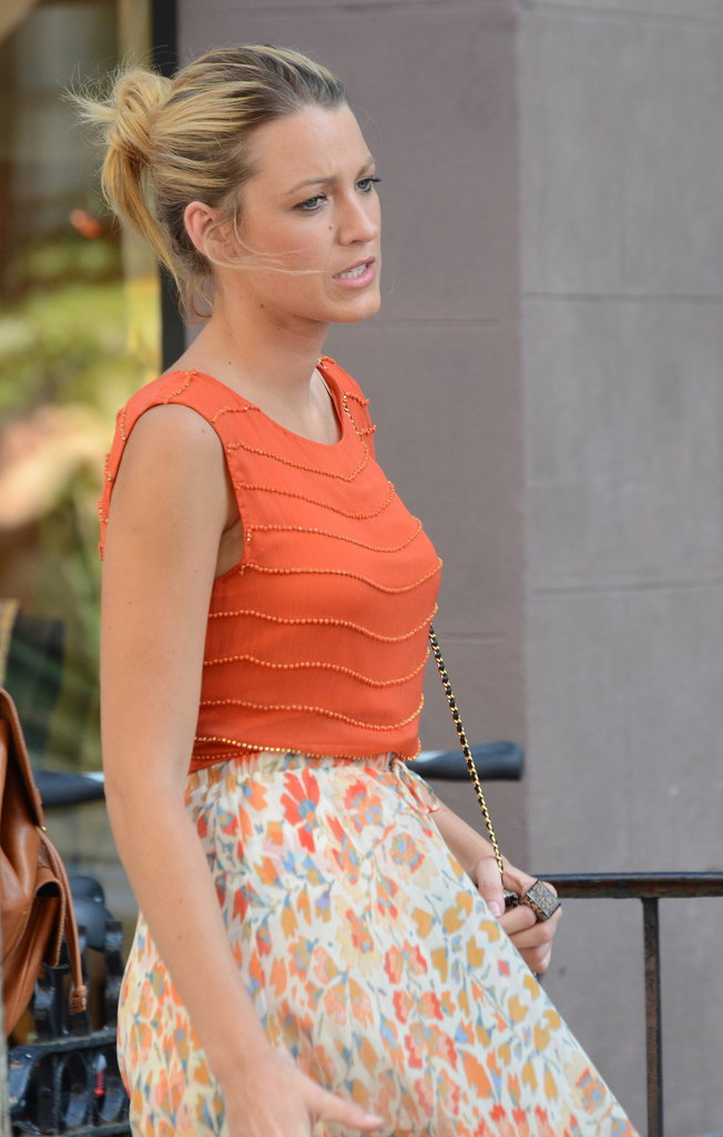 Blake Lively wore an orange top and long skirt for a Gossip Girl scene.