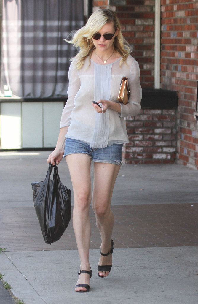 Kirsten Dunst walked out of a convenience store and headed back to her car.