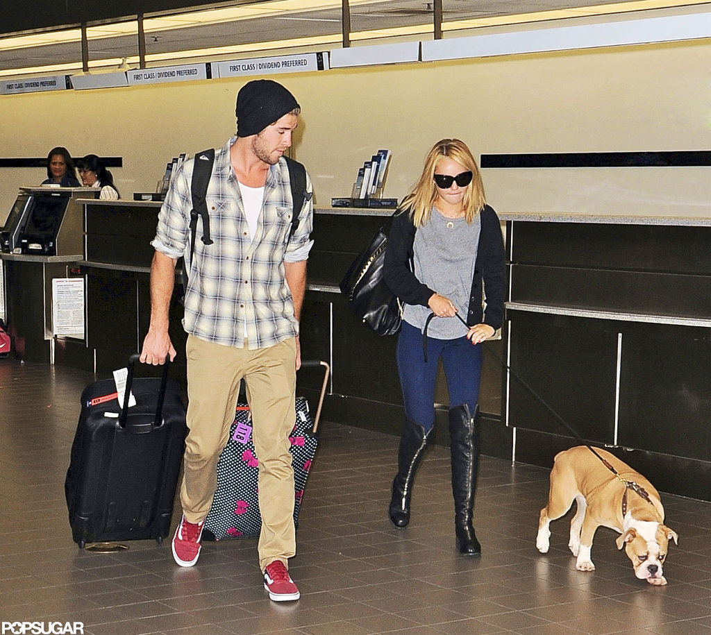 Liam Hemsworth and Miley Cyrus walked through LAX.