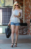 Kirsten Dunst paired her jean shorts with a loose-fitting top.