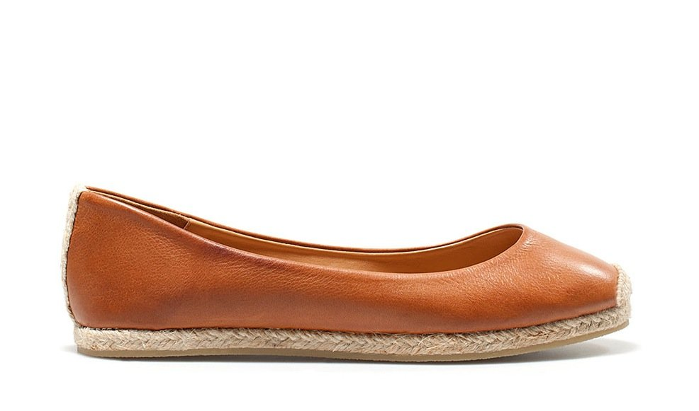 "Evoke a summery vibe — without veering into beach-ready territory — with a leather ballet flat infused with a jute sole. We call this the perfect example of having ""the best of both worlds."" Zara Jute Ballerina ($70)"