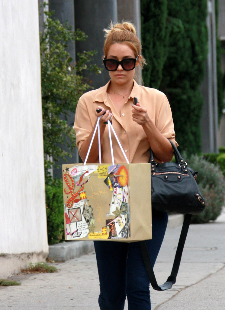 Lauren Conrad sported sunglasses and a high bun while shopping.