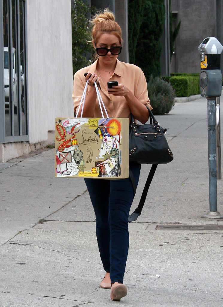 Lauren Conrad checked her phone while shopping in West Hollywood.