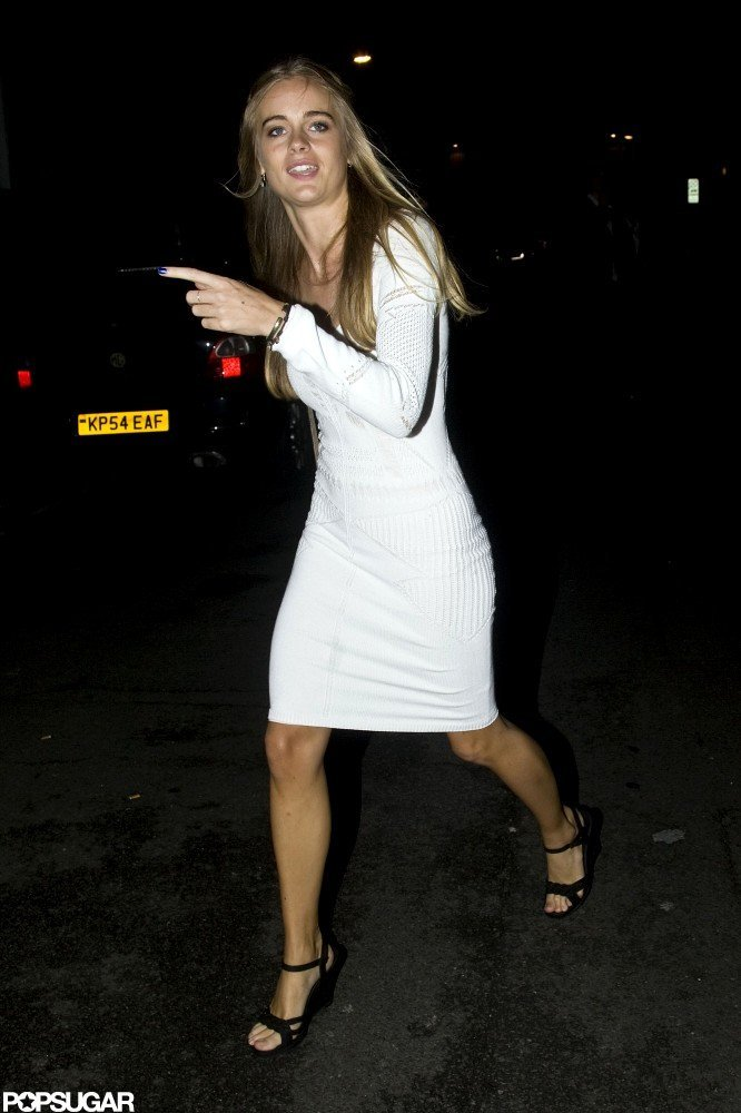 Prince Harry's friend contrasted her white dress with black heels.