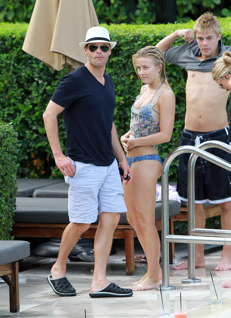 Julianne Hough wore bikini bottoms poolside with Ryan Seacrest in July 2011 in Miami.