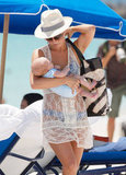 Julianne Hough cradled a baby during a May 2011 day at the beach in Miami.