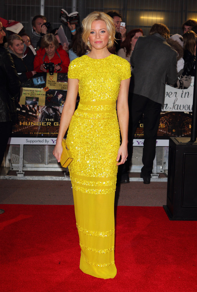 She isn't afraid of brighter than bright colors. Case in point: this saturated yellow Bill Blass cap-sleeved gown she wore at the London premiere of The Hunger Games.