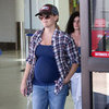Reese Witherspoon Shows Her Bump at LAX