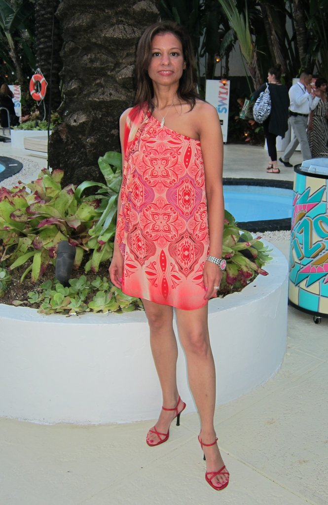 An exotic printed silk dress gets an elegant touch via strappy red sandals.
