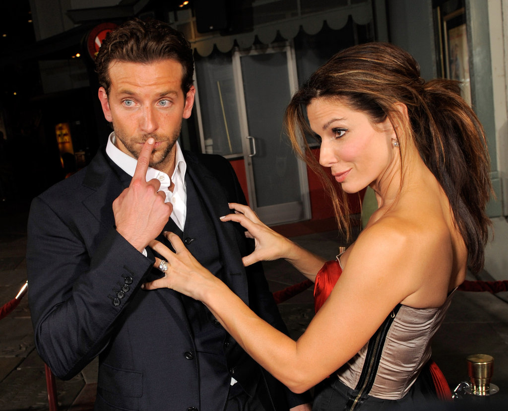 Bradley Cooper and Sandra Bullock put on a show for photographers at their August 2009 LA premiere of All About Steve.