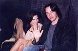 Sandra Bullock and Keanu Reeves were all smiles at the September 1996 ShoWest presentation in Las Vegas.