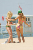 AnnaLynne McCord applied sunscreen on the beach.