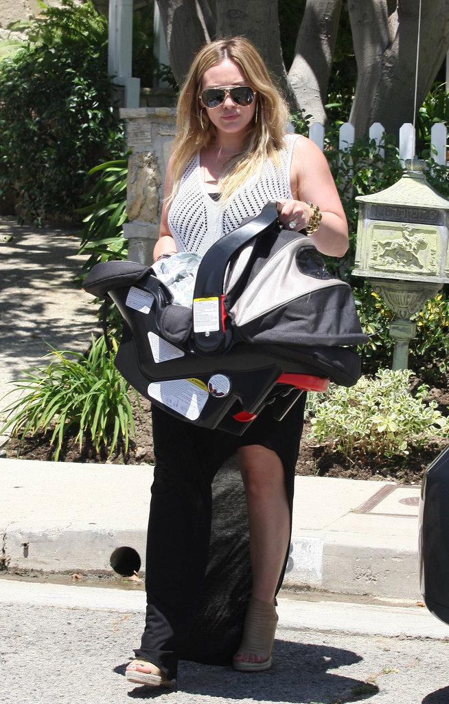 Hilary Duff wore a long black skirt and white sweater to take Luca to a birthday party in LA.