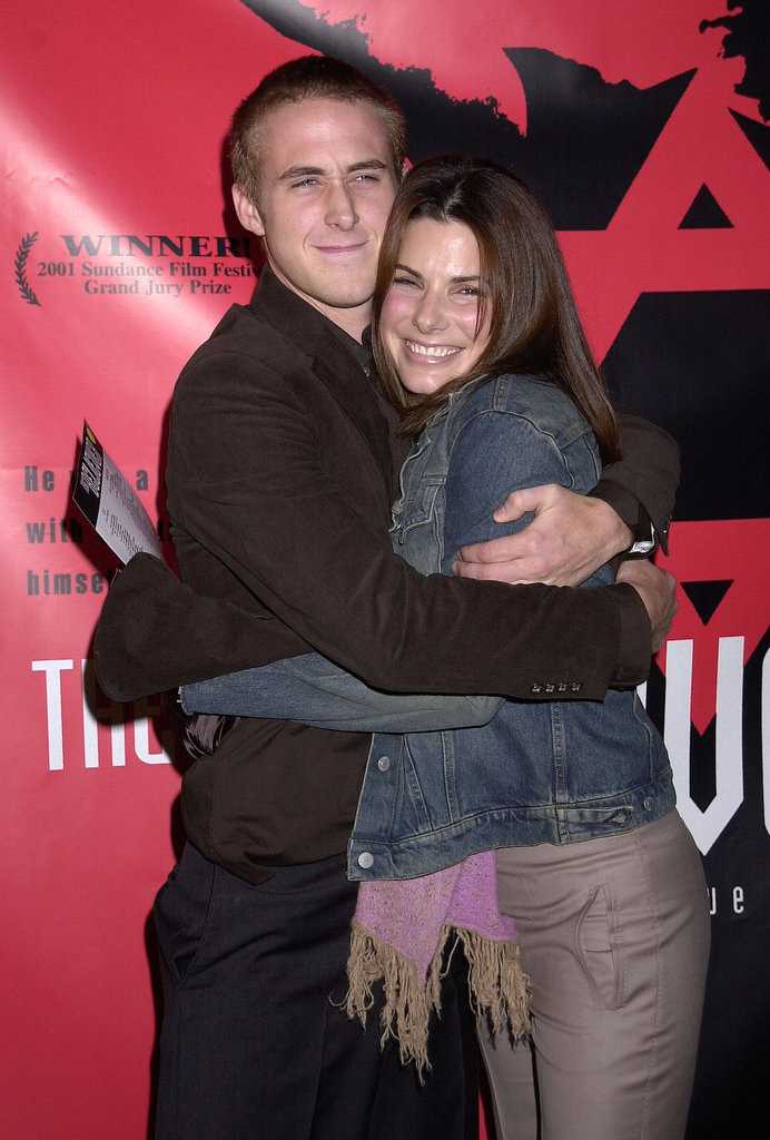 Ryan Gosling gave Sandra Bullock a hug at the September 2001 LA premiere of The Believer.