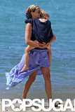 Julia Roberts carried one of her children in Hawaii.