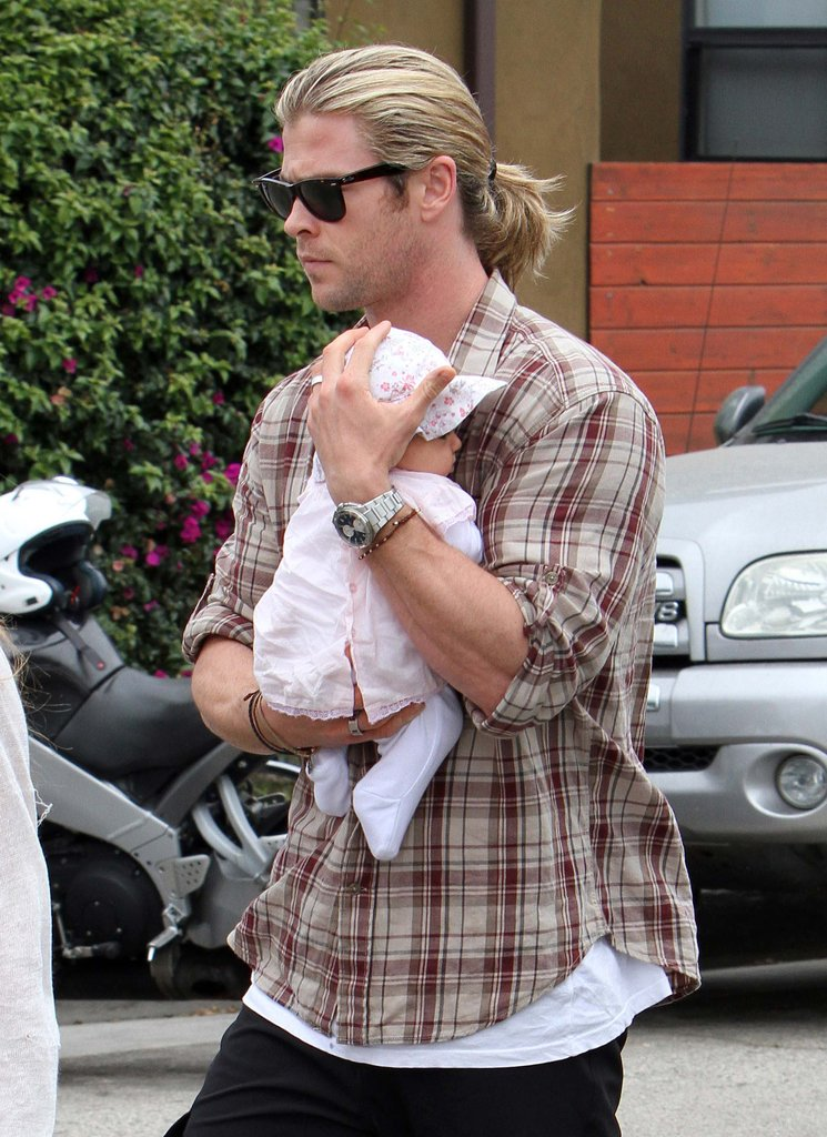 Chris Hemsworth held his new baby girl, India, close while out for a stroll in LA.