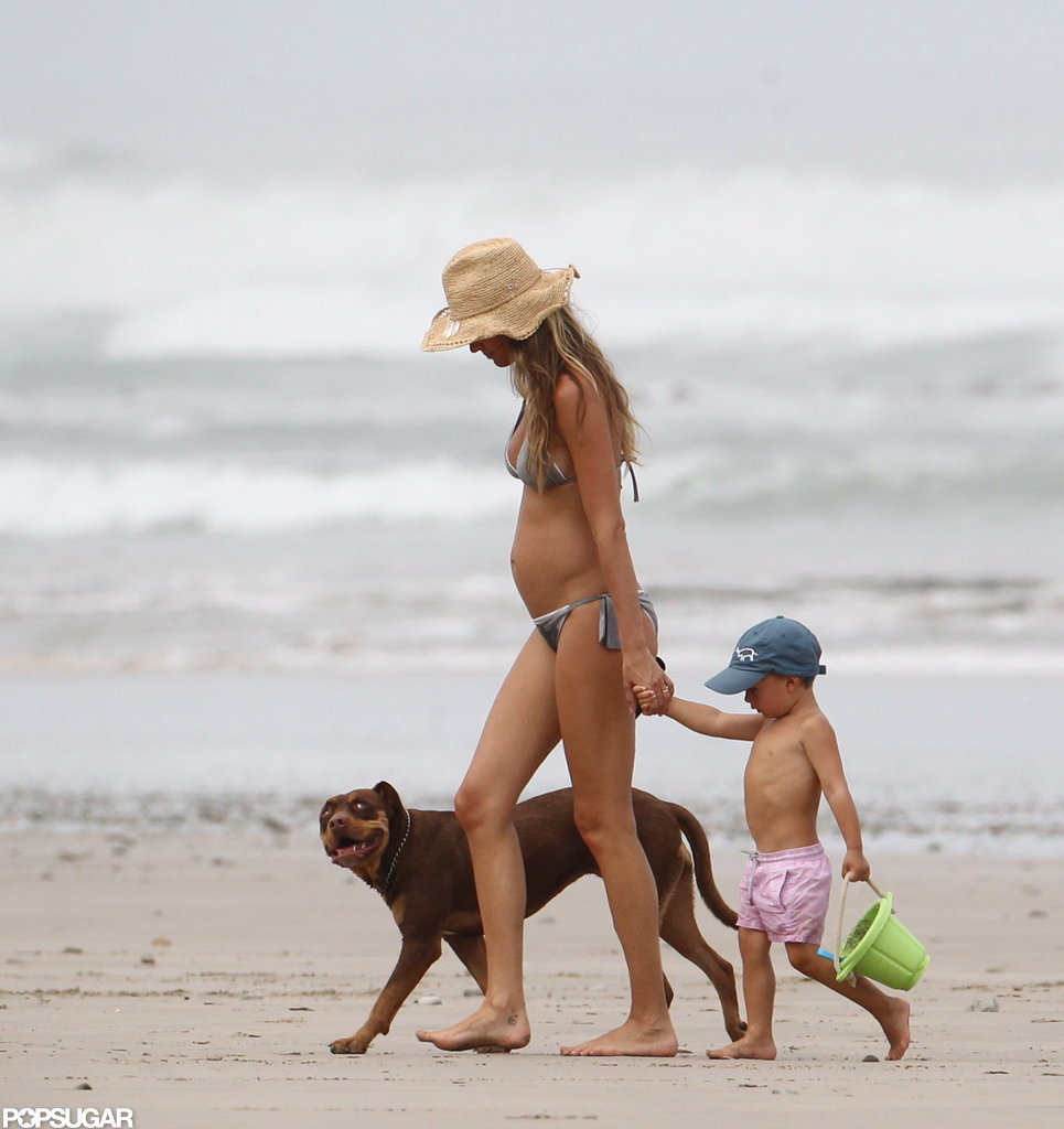 Pregnant Gisele Bundchen hit the beach with Ben and their dog.