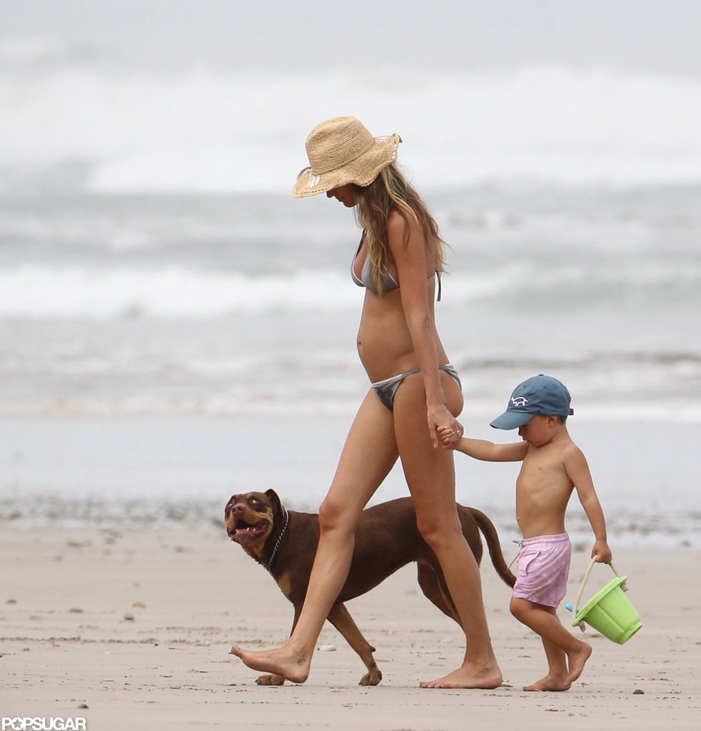 Gisele Bundchen walked in Costa Rica with Ben and a dog.