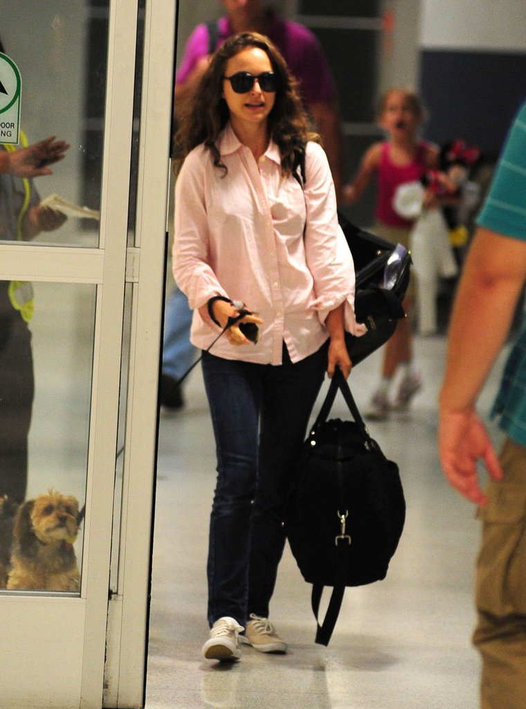 Natalie Portman carried a black carry-on bag.