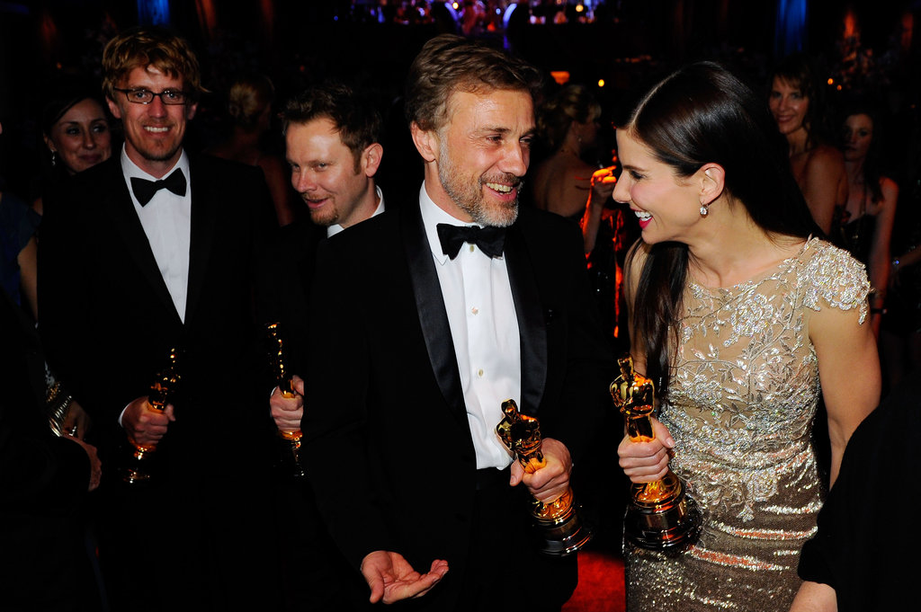 Sandra Bullock and Christoph Waltz shared congratulatory smiles following their Oscar wins at the March 2010 Academy Awards in LA.