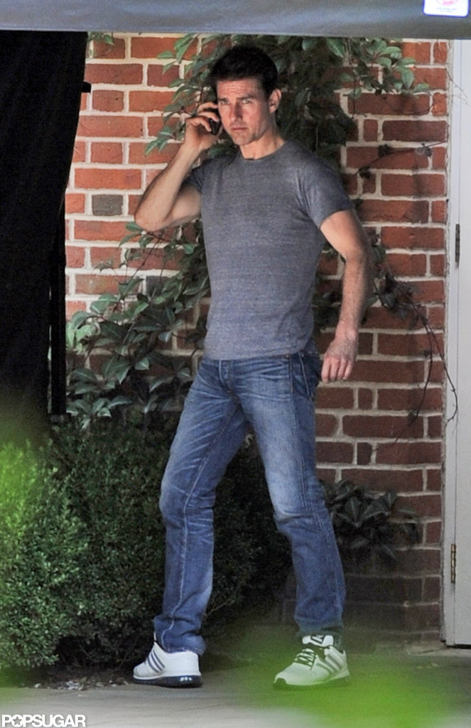 Tom Cruise chatted on his phone.