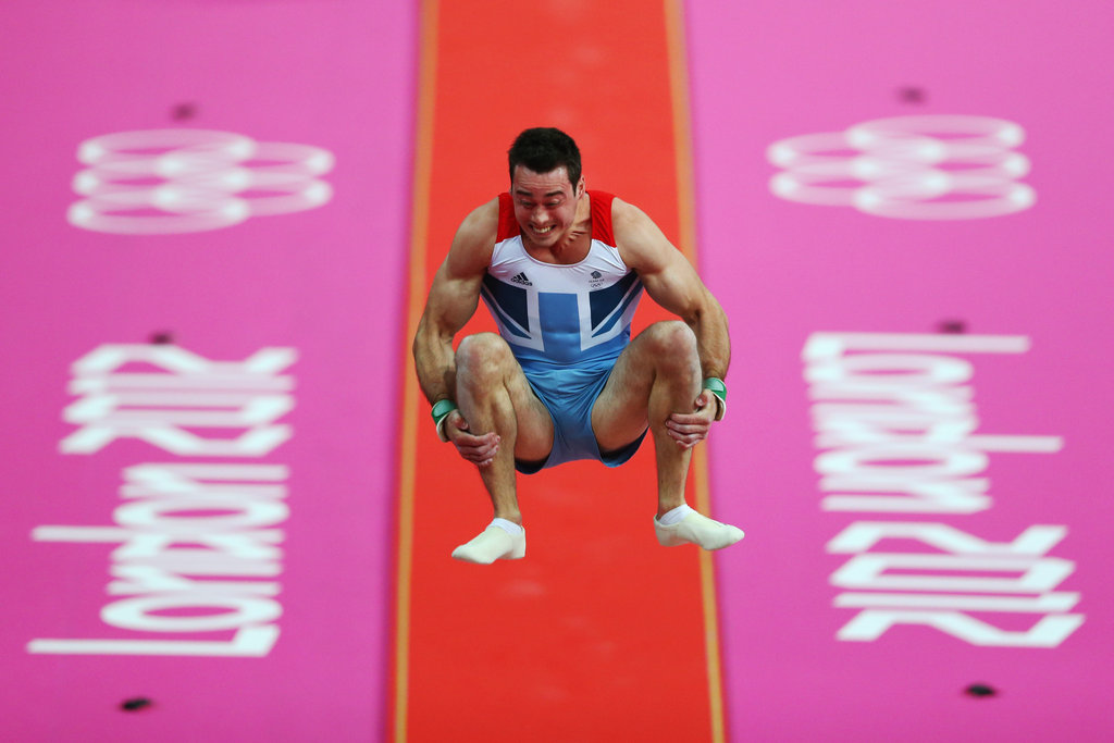 Kristian Thomas of Great Britain takes flight from the vault.