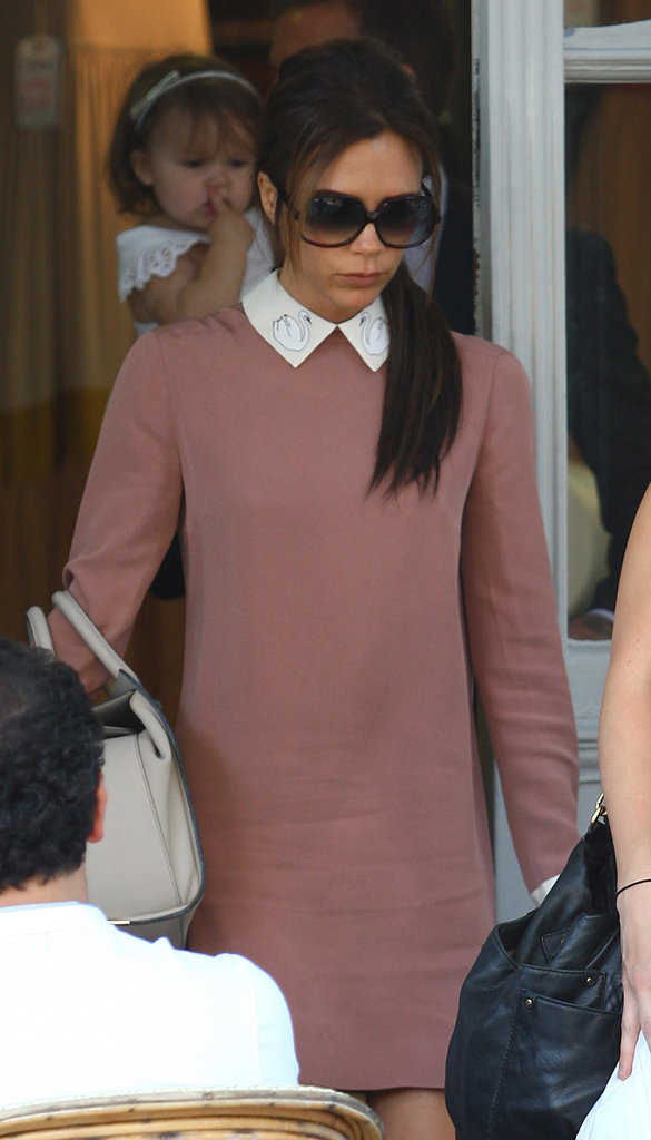 Victoria Beckham headed out of the restaurant in London ahead of David Beckham and Harper Beckham.