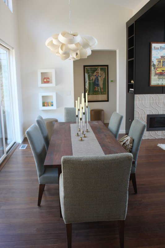 To the immediate left is the dining area. Lee upholstered chairs surround a Roost walnut table.