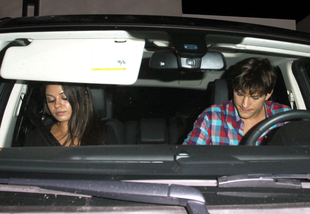 Ashton Kutcher and Mila Kunis in their car.