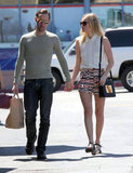 Kate Bosworth, with beau Michael Polish, showed off a breezy blouse and Topshop shorts out in LA.