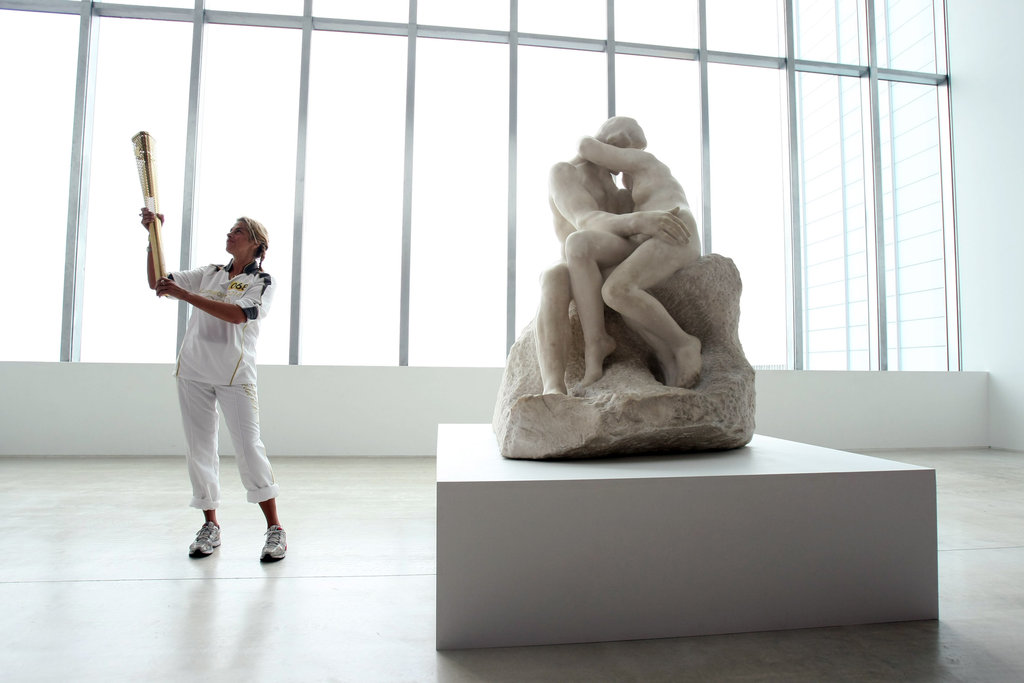 "British artist and Olympic torchbearer Tracey Emin posed in the Turner Contemporary Gallery beside ""The Kiss"" sculpture by Rodin in Margate, England."