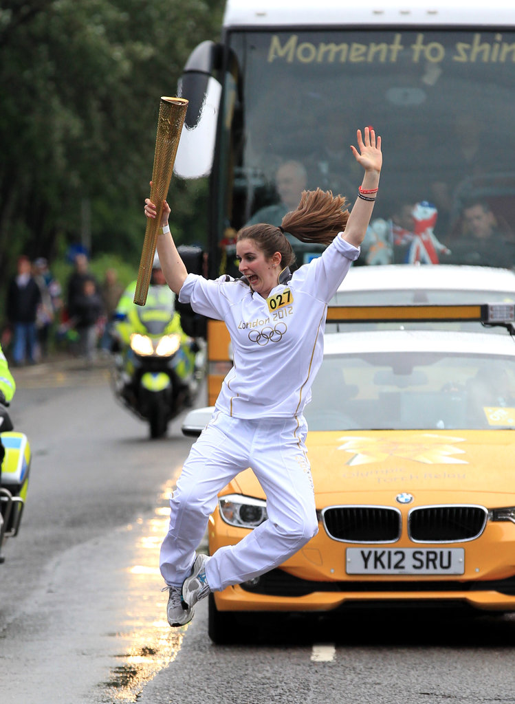 Torchbearer Ellie Koyander goofed off in the streets while carrying the Olympic torch in Burton upon Trent, England.