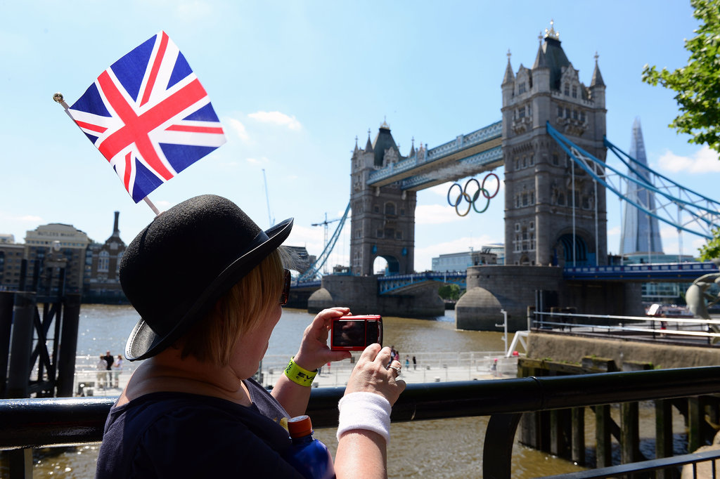 A woman took a picture of the Tower Bridge in London.
