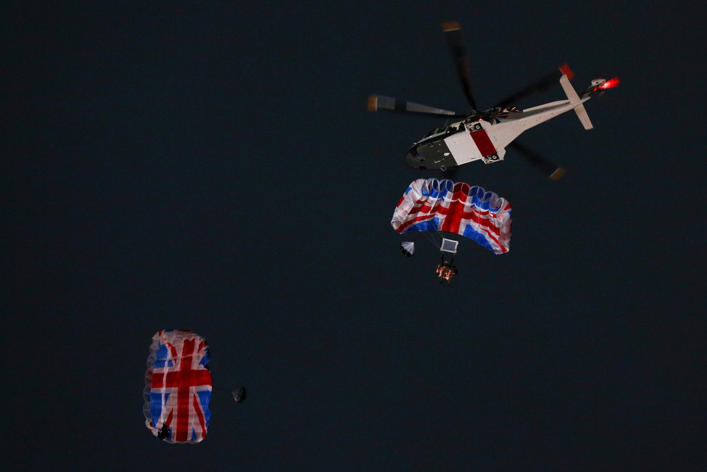 "James Bond and ""the queen"" dropped from the sky."