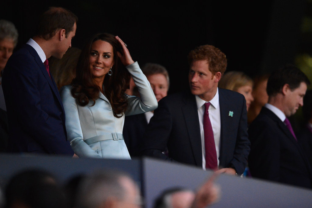 Princes William and Harry sat by Kate Middleton.