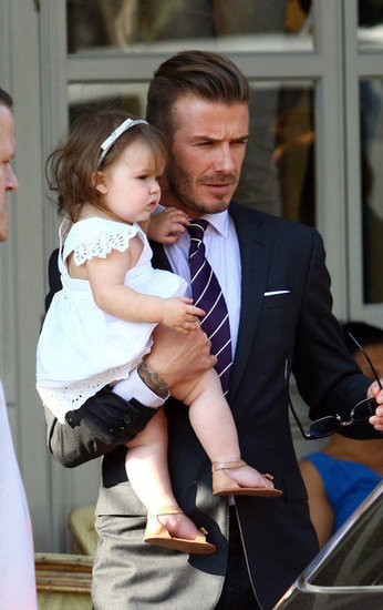 David and Victoria Beckham took 1-year-old Harper to lunch in London on July 26.